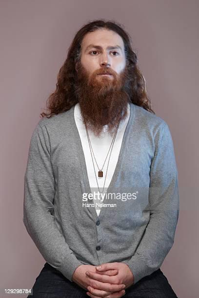 Portrait of bearded mid-adult man wearing grey cardigan