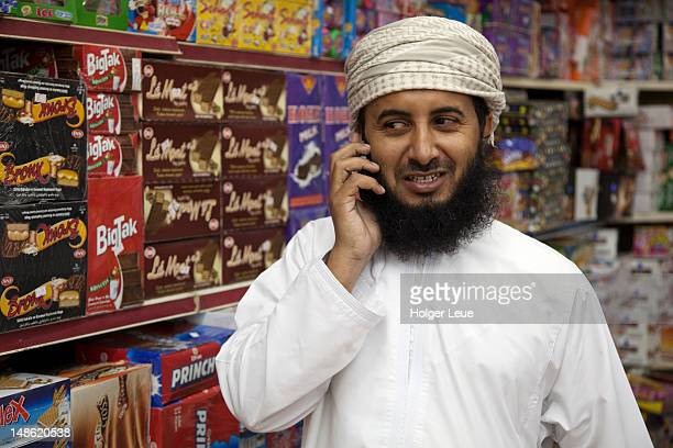 Portrait of bearded Omani man with mobile phone.