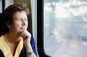 Portrait of beautiful 70 years old woman sitting in the train