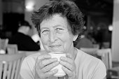 Portrait of beautiful 70 years old woman drinking morning coffee