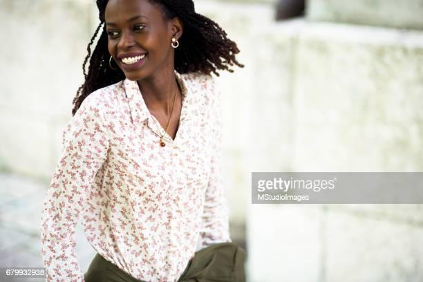 Portrait of beautiful African woman walking