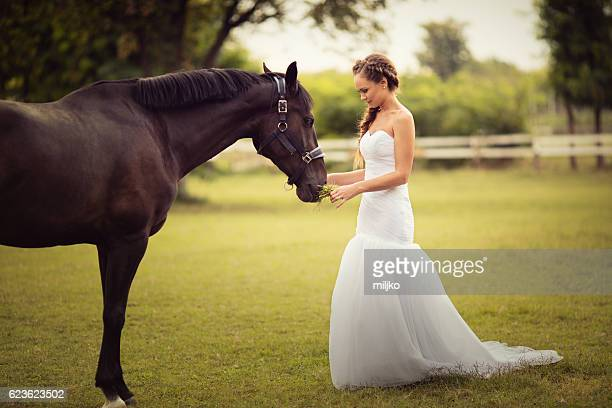 Portrait of beautiful bride with horse