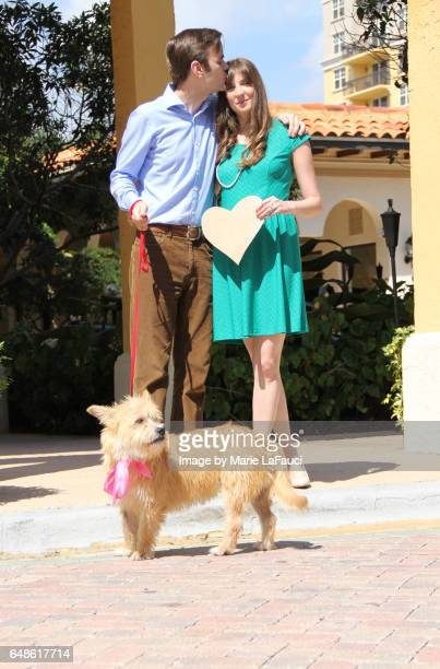 Portrait of beautiful couple with pet dog