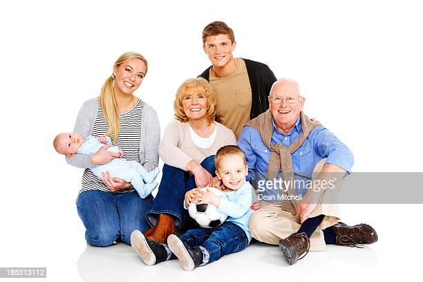 Portrait of beautiful family sitting on floor