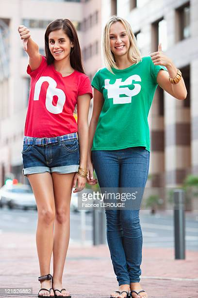 Portrait of beautiful female friends smiling and gesturing