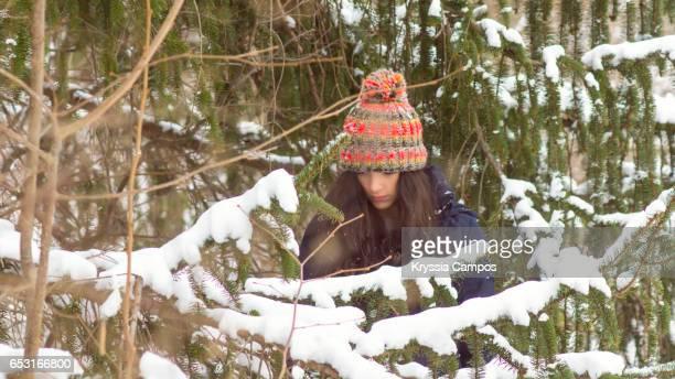 Portrait of beautiful girl exploring in park in winter
