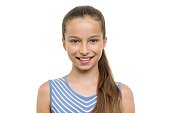 Portrait of beautiful girl of 10, 11 years old. Child with perfect white smile, isolated on white background.