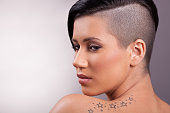 Portrait of  beautiful girl with a Mohawk hairstyle