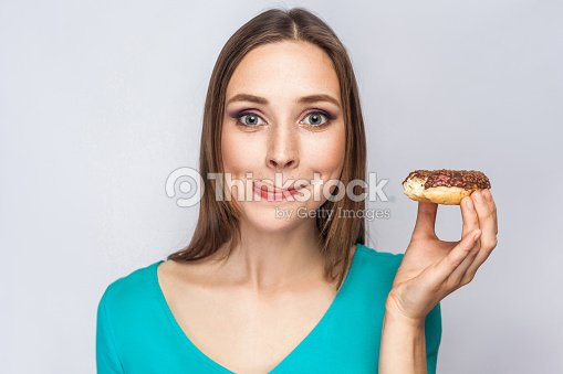 Portrait Of Beautiful Girl With Chocolate Donuts Stock Photo