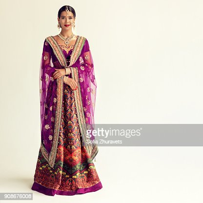 Portrait Of Beautiful Indian Girl Dressed In A Traditional National Suit And Gilded Hand Made Ornate Blouse And Shawl