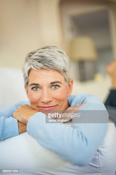 Portrait of beautiful mature woman with short grey hair and blue eyes