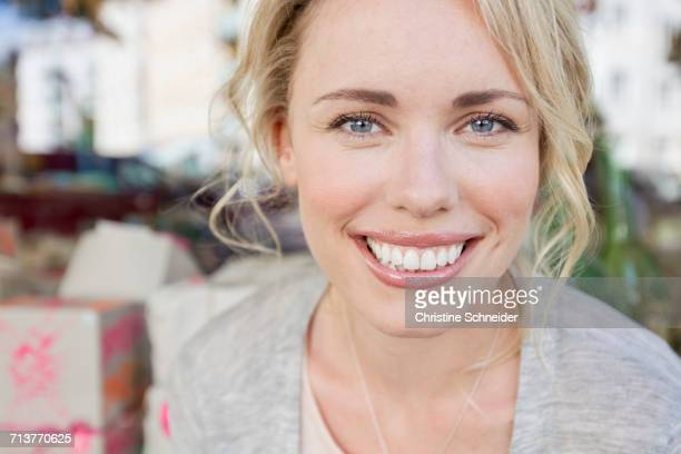 Portrait of beautiful mid adult woman in city
