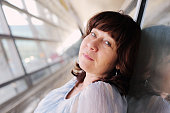 Portrait of beautiful real 45 years old woman standing in the airport