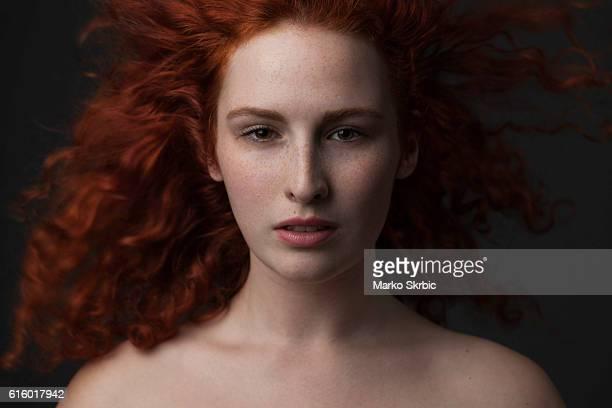 Portrait of beautiful redhead fashion model