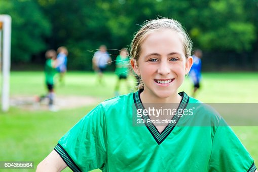 Portrait of beautiful teenage female soccer champion