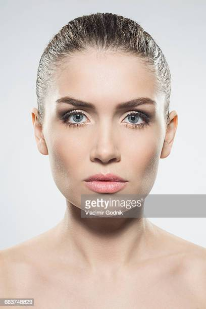 Portrait of beautiful woman against white background