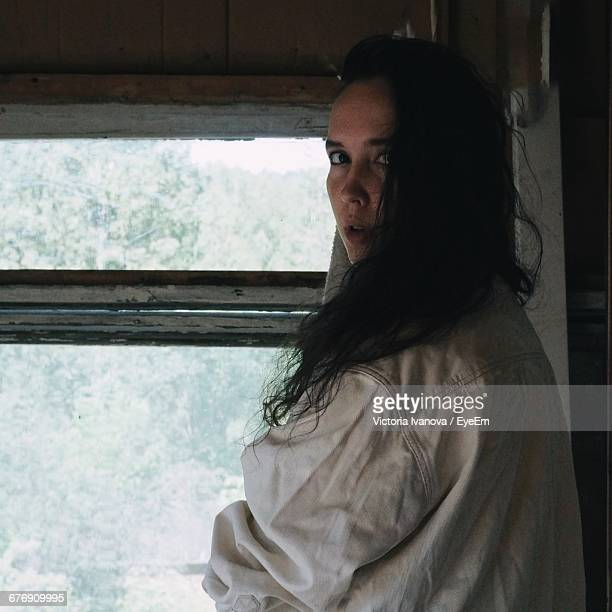 Portrait Of Beautiful Woman By Window At Home