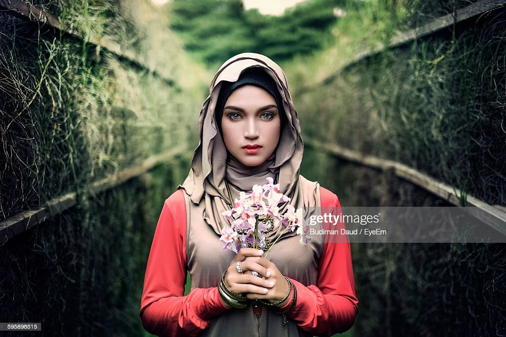 Portrait Of Beautiful Woman Holding Flowers Stock Photo ...