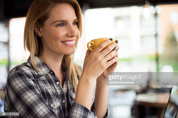Portrait of beautiful woman in cafeteria