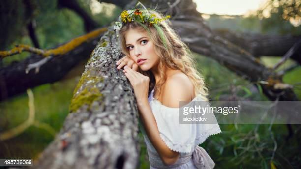 Portrait of beautiful woman in woods