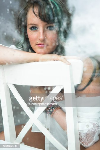Portrait of beautiful woman leaning on chair. : Stock Photo