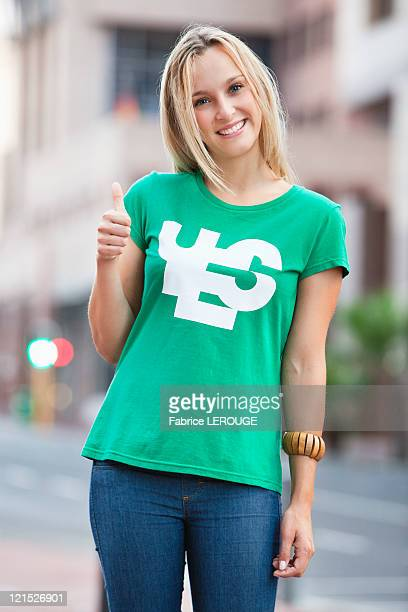 Portrait of beautiful woman showing thumbs up sign