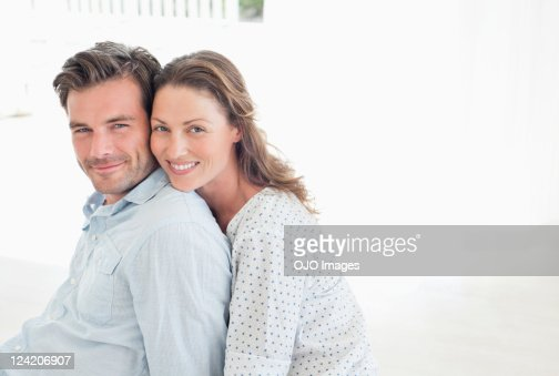 Portrait of beautiful woman smiling and leaning on her boyfriend's shoulders : ストックフォト