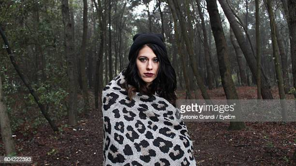 Portrait Of Beautiful Woman Standing Against Trees In Forest