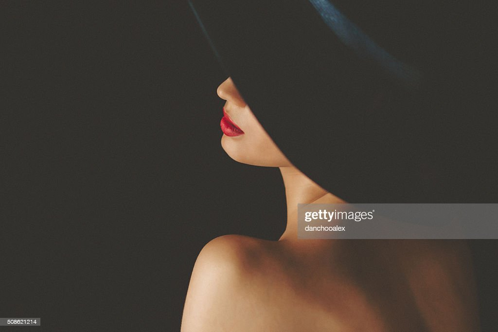 Portrait of beautiful woman wearing retro ladies' hat : Stock Photo