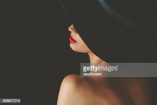 Portrait of beautiful woman wearing retro ladies' hat : Stock Photo