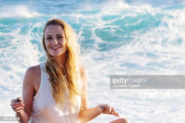 Portrait Of Beautiful Woman With Long Hair At Beach