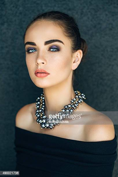 Portrait of beautiful woman with necklace