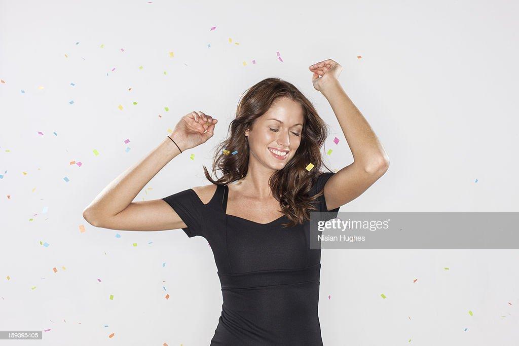 Portrait of Beautiful young woman confetti : Stock Photo