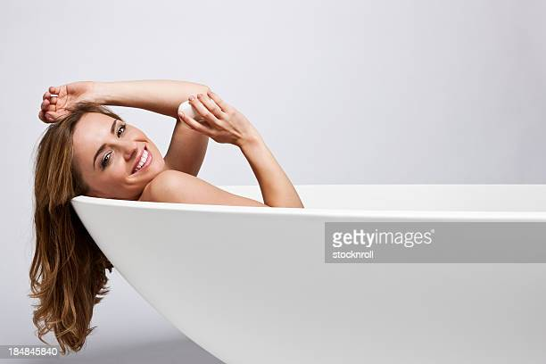 Portrait of beautiful young woman in a bath