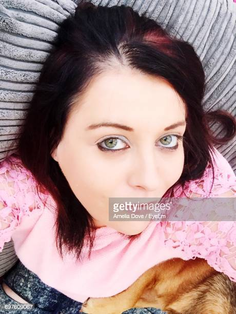 Portrait Of Beautiful Young Woman Resting On Chair