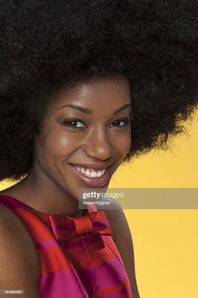 portrait of beautiful young woman with large afro