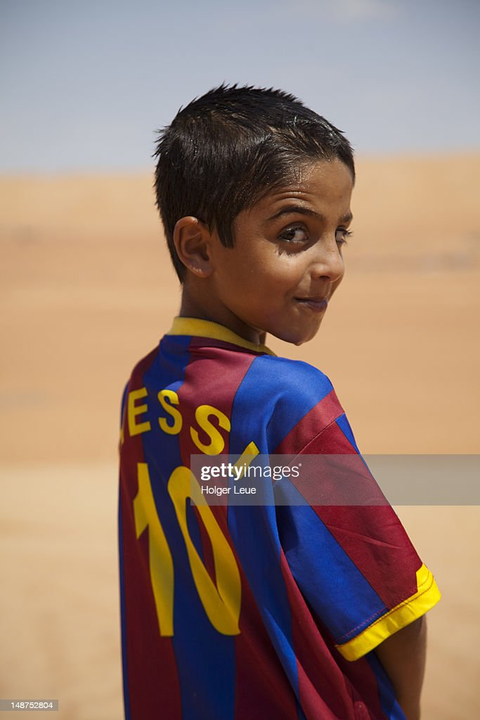 Portrait of Bedouin boy with Messi football jersey. : Stock Photo