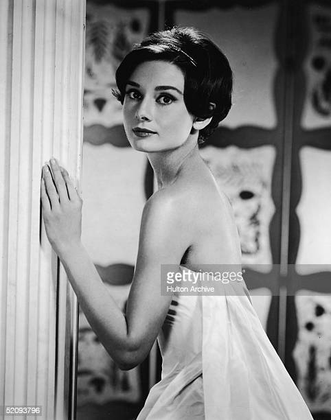 Portrait of Belgianborn American actress Audrey Hepburn as she looks over her shoulder in a doorway early 1950s