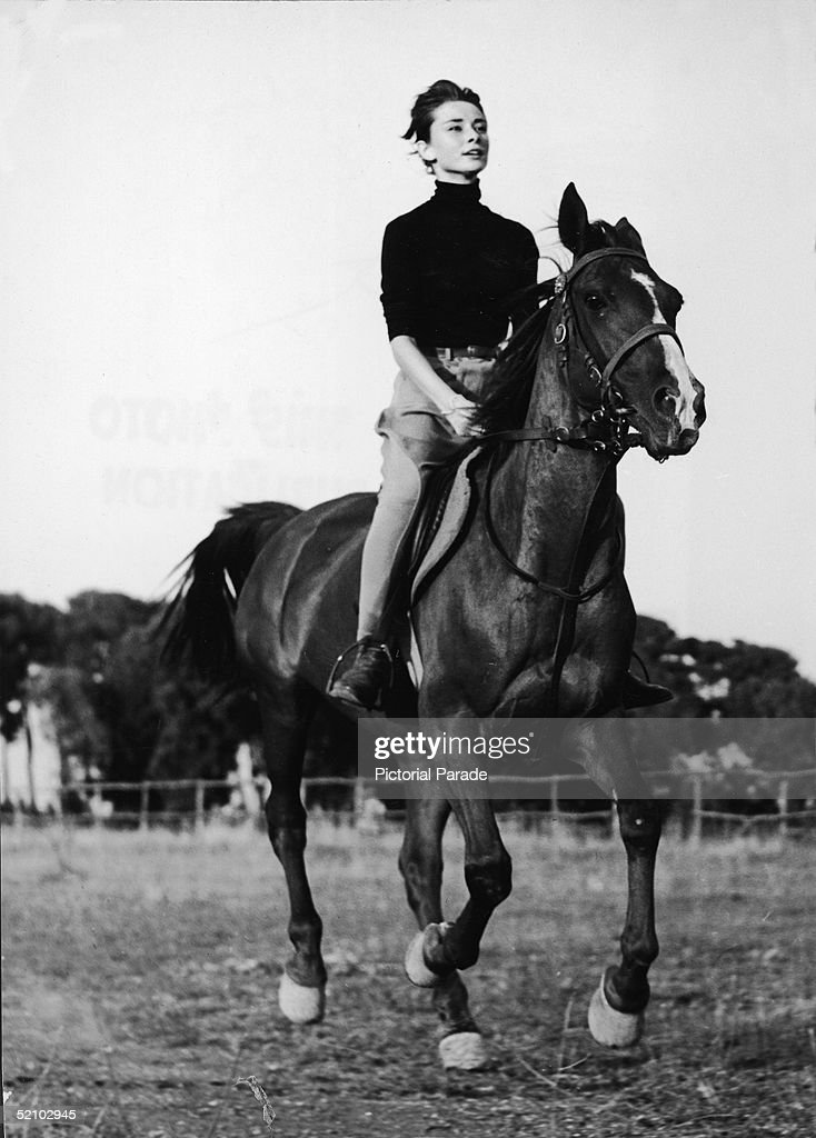 Portrait of Belgian-born American actress Audrey Hepburn (1929 - 1993) as she rides a horse and wears chaps, 1959.