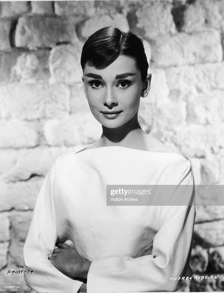 Portrait of Belgian-born American actress <a gi-track='captionPersonalityLinkClicked' href=/galleries/search?phrase=Audrey+Hepburn&family=editorial&specificpeople=86470 ng-click='$event.stopPropagation()'>Audrey Hepburn</a> (1929 - 1993) ina white long-sleeved dress, mid 1950s.