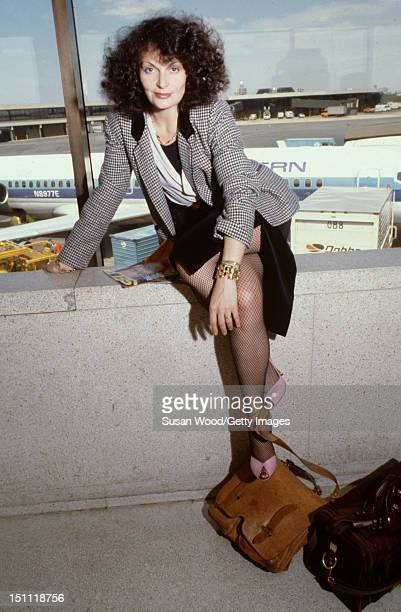 Portrait of Belgianborn fashion designer Diane von Furstenberg as she sits on a ledge at John F Kennedy Airport Queens New York New York May 1979