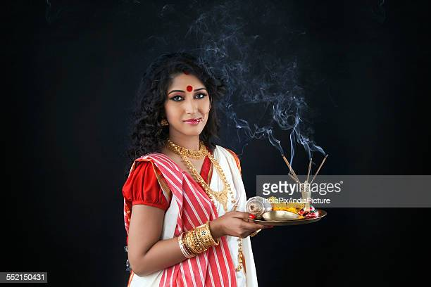 Portrait of Bengali woman holding a puja thali