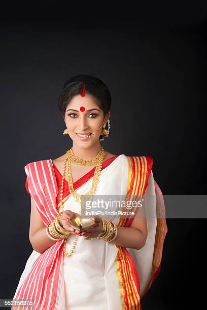 Portrait of Bengali woman with diya