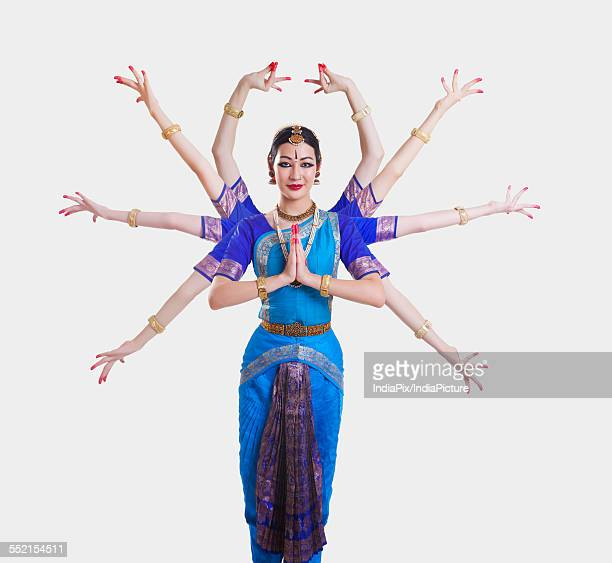 Portrait of Bharatanatyam dancer with multiple mudras over white background