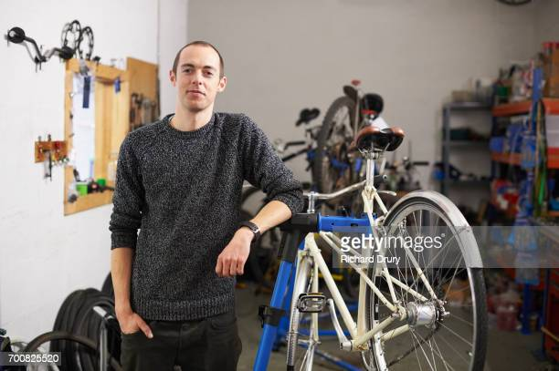 Portrait of bicycle mechanic in workshop
