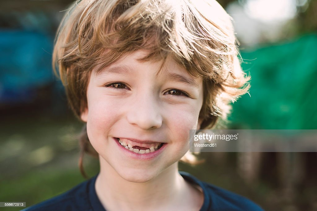 Portrait of blond boy with a big smile
