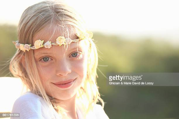 Portrait of blond girl wearing flower headband, Buonconvento, Tuscany, Italy