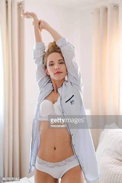 Portrait of blond woman wearing underwear and pyjama jacket