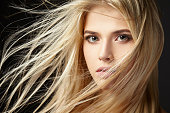 Portrait of a beautiful blonde girl with fluttering hair.