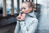 Portrait of blonde sporty woman in city scape